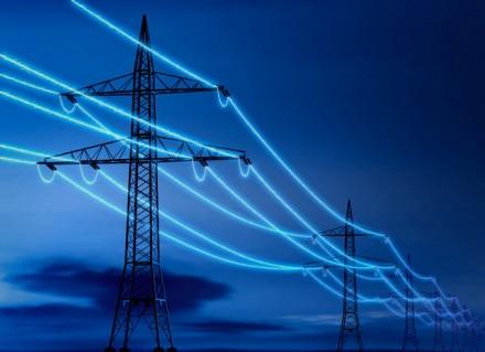 Illuminated power lines --- Image by © Matthias Kulka/Corbis